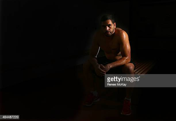 Greg Inglis of the South Sydney Rabbitohs NRL team poses during a portrait session at Redfern Oval on April 23 2014 in Sydney Australia