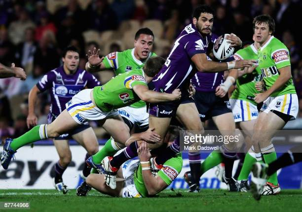Greg Inglis of the Storm is tackled during the round 10 NRL match between the Melbourne Storm and the Canberra Raiders at Olympic Park on May 18 2009...