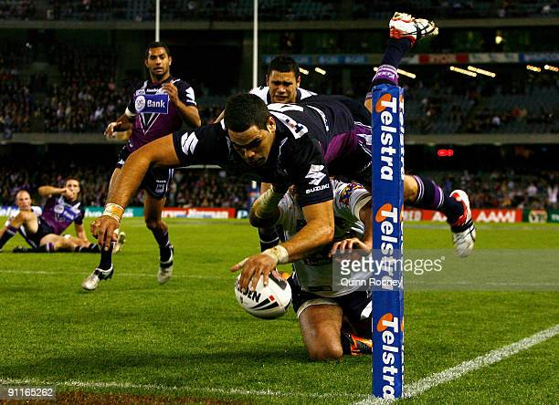 Greg Inglis of the Storm scores a try during the second NRL Preliminary Final match between the Melbourne Storm and the Brisbane Broncos at Etihad...