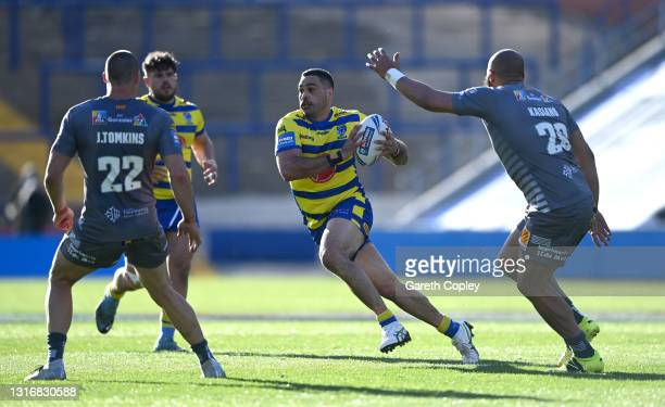 Greg Inglis of Warrington gets past Joel Tomkins and Sam Kasiano of Catalans during the Betfred Challenge Cup quarter final between Catalans Dragons...