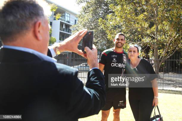 Greg Inglis poses with a supporter before speaking to the press during a South Sydney Rabbitohs NRL media opportunity at Redfern Oval on September 18...