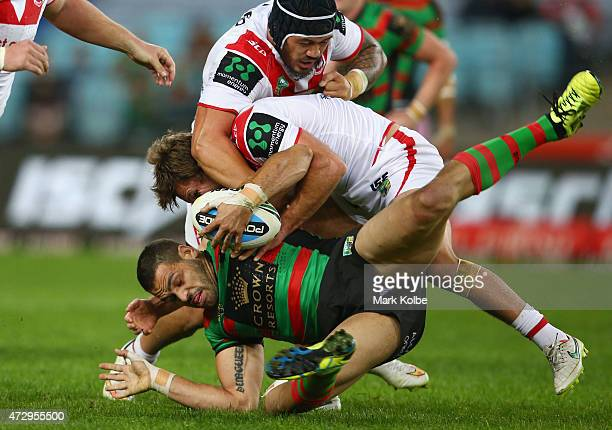 Greg Inglis Rabbitohs is tackled during the round nine NRL match between the South Sydney Rabbitohs and the St George Illawarra Dragons at ANZ...