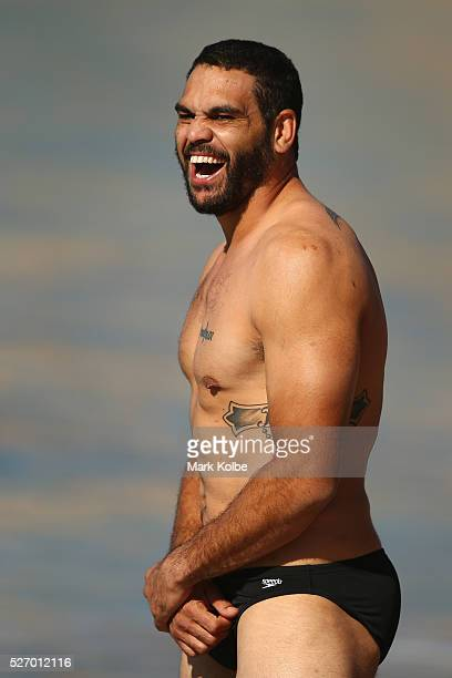 Greg Inglis shares a laugh with a team mate during the Australia Kangaroos Test team recovery session at Coogee Beach on May 2 2016 in Sydney...