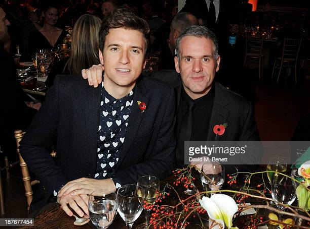 Greg James and Chris Moyles attend the BBC Children in Need Gala hosted by Gary Barlow at The Grosvenor House Hotel on November 11 2013 in London...
