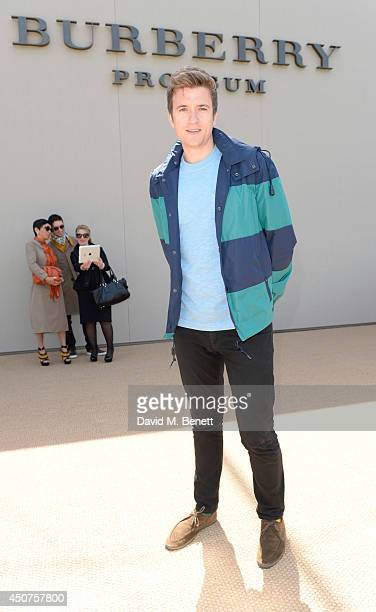 Greg James arrives at Burberry Prorsum SS15 during London Collections Men at Kensington Gardens on June 17 2014 in London England