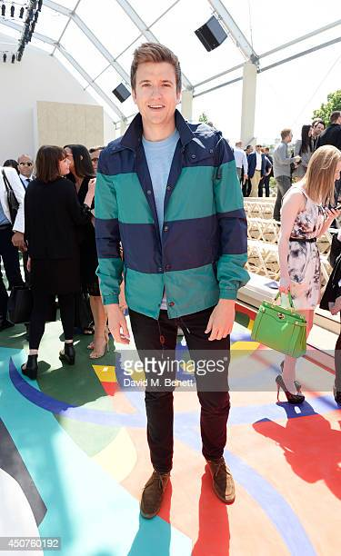 Greg James attends the front row at Burberry Prorsum SS15 during London Collections Men at Kensington Gardens on June 17 2014 in London England