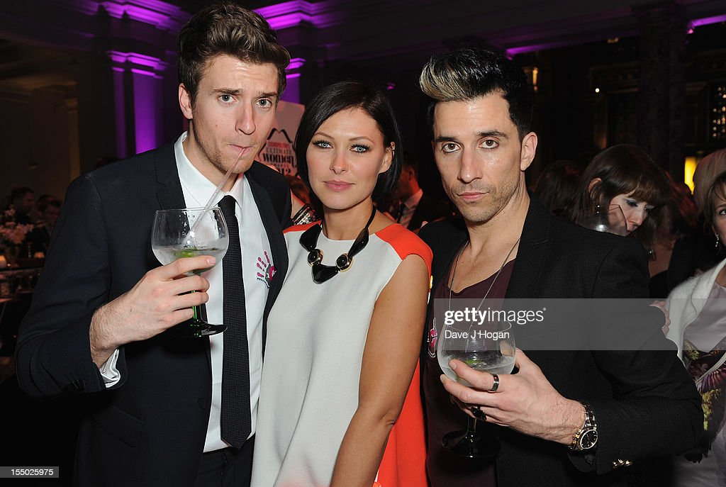 Greg James, Emma Willis and Russell Kane poses at the winners boards at the Cosmopolitan Ultimate Woman of the Year Awards after party at Victoria & Albert Museum on October 30, 2012 in London, England.