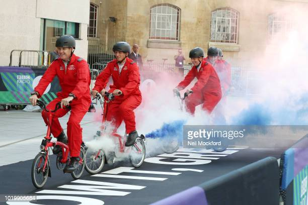 Greg James performing a stunt with the Red Arrows Bike Display Team at the BBC Radio One Studios for his first new Breakfast Show on August 20 2018...