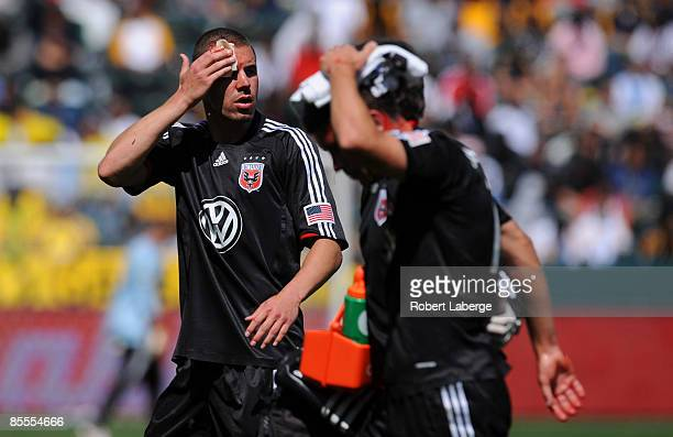 Greg Janicki and Devon McTavish of DC United walk off the field after colliding against each other during the game against the Los Angeles Galaxy at...