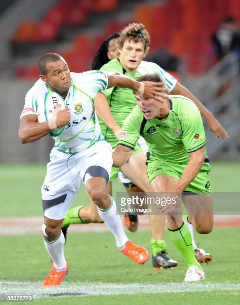 Greg Jeloudev of Australia tackles Cornal Hendricks of South Africa during the match between South Africa and Australia on day one of the 2011 IRB...