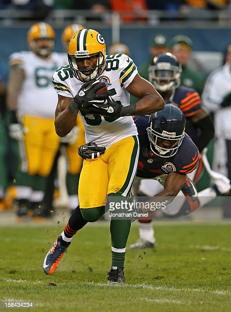 Greg Jennings of the Green Bay Packers catches a pass in front of Kelvin Hayden of the Chicago Bears at Soldier Field on December 16 2012 in Chicago...