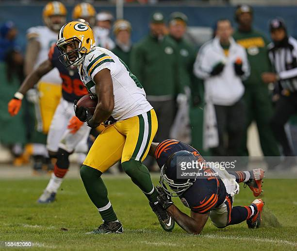 Greg Jennings of the Green Bay Packers tries to break away from Kelvin Hayden of the Chicago Bears at Soldier Field on December 16 2012 in Chicago...
