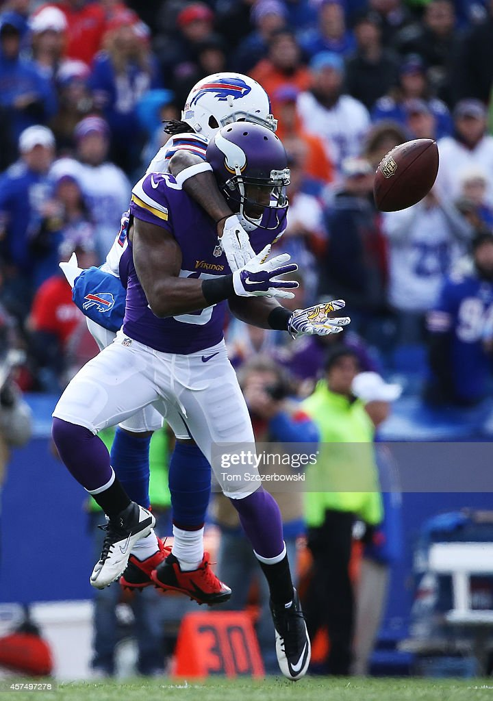 Greg Jennings #15 of the Minnesota Vikings makes a catch as Nickell Robey #37 of the Buffalo Bills defends during the first half at Ralph Wilson Stadium on October 19, 2014 in Orchard Park, New York.