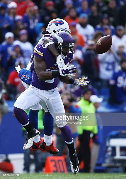 Greg Jennings of the Minnesota Vikings makes a catch as Nickell Robey of the Buffalo Bills defends during the first half at Ralph Wilson Stadium on...