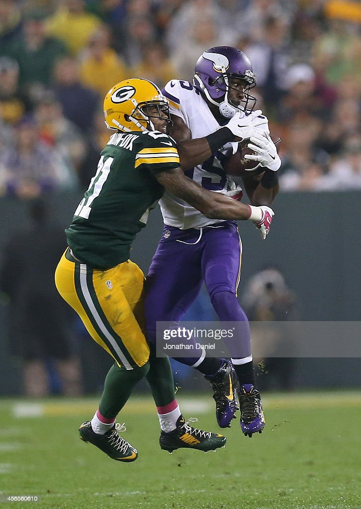 Greg Jennings #15 of the Minnesota Vikings receives a 17 yard pass against Ha Ha Clinton-Dix #21 of the Green Bay Packers in the third quarter at Lambeau Field on October 2, 2014 in Green Bay, Wisconsin. Packers defeat Vikings 42-10.