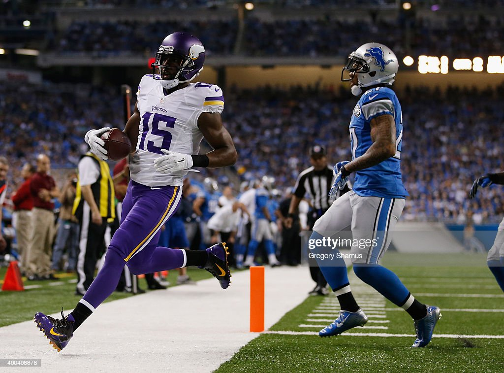 Greg Jennings #15 of the Minnesota Vikings scores a second quarter touchdown in front of Reggie Bush #21 of the Detroit Lions at Ford Field on December 14, 2014 in Detroit, Michigan.