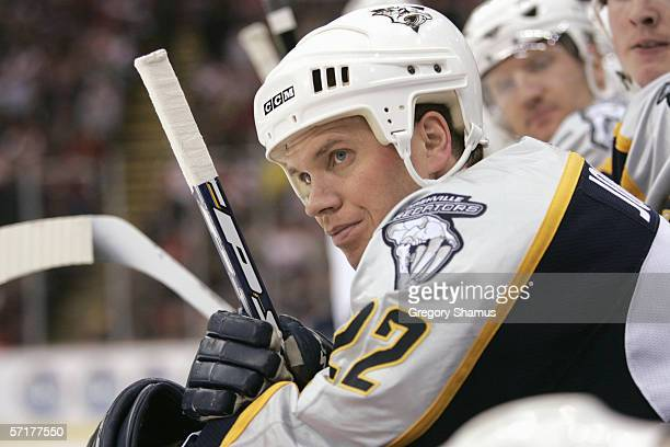 Greg Johnson of the Nashville Predators looks on from the bench during the game against the Detroit Red Wings on March 21 2006 in Detroit Michigan...