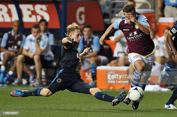 Greg Jordan of the Philadelphia Union kicks the ball away from Andreas Weimann of Aston Villa at PPL Park on July 18 2012 in Chester Pennsylvania...