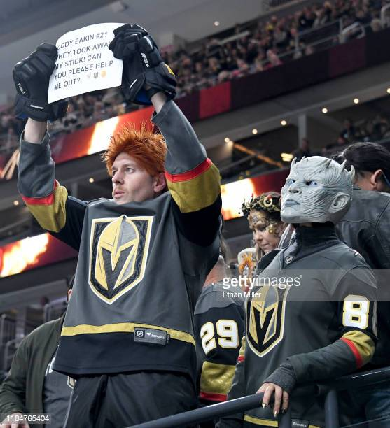 Greg Kelley , of Nevada, dressed as Cody Eakin of the Vegas Golden Knights for Halloween, and Christine Takafuji, dressed as the Knight King...
