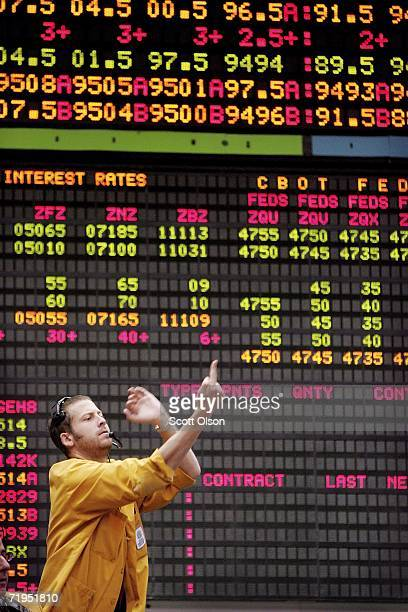 Greg Kern signals prices from the Eurodollar options pit at the Chicago Mercantile Exchange following the announcement from the Federal Open Market...