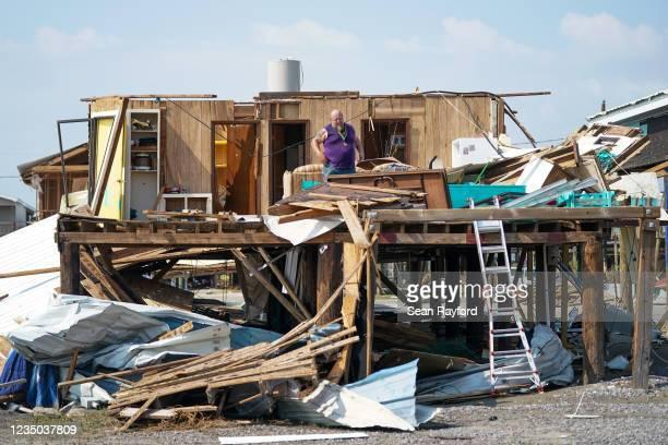 Greg Knight looks through belongings at his storm damaged house after Hurricane Ida on September 3, 2021 in Grand Isle, Louisiana. Ida made landfall...
