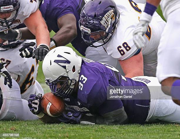 Greg Kuhar of the Northwestern Wildcats recovers a fumble against the Western Illinois Leathernecks on September 20 2014 at Ryan Field in Evanston...