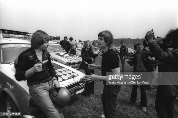 Greg Lake and Carl Palmer of Emerson, Lake & Palmer eating ice lollies in the paddock at the Radio Luxembourg Day at Brands Hatch Circuit in West...