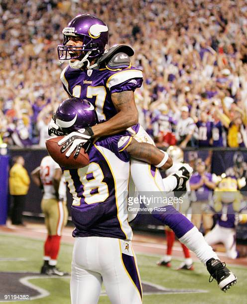 Greg Lewis of the Minnesota Vikings celebrates with teammate Sidney Rice after catching a 32yard pass for a touchdown with two seconds on the clock...