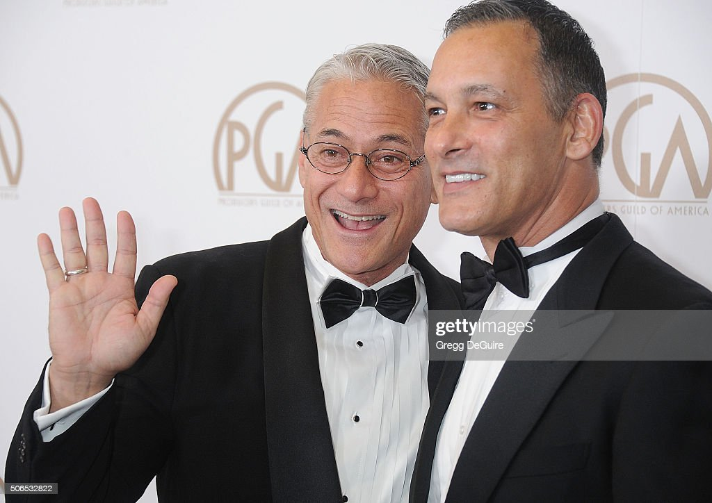 Greg Louganis and Johnny Chaillot arrive at the 27th Annual Producers Guild Awards at the Hyatt Regency Century Plaza on January 23, 2016 in Century City, California.