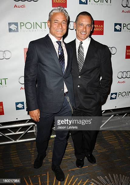 Greg Louganis and Johnny Chaillot attend the Voices On Point musical gala to benefit the Point Foundation at the Hyatt Regency Century Plaza on...