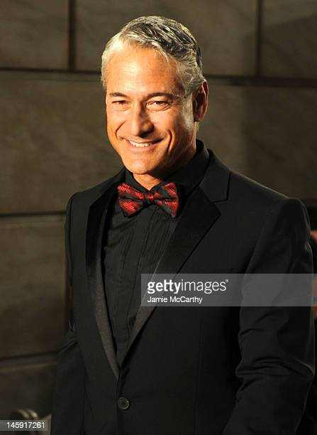 Greg Louganis walks the runway during the 3rd annual amfAR Inspiration Gala New York at The New York Public Library Stephen A Schwarzman Building on...