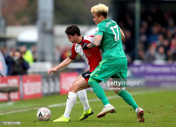 Greg Luer of Woking is challenged by Adalberto Penaranda of Watford during the FA Cup Third Round match between Woking and Watford at Kingfield...