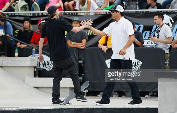 Greg Lutzka greets New York Jets quarterback Mark Sanchez during the Maloof Money Cup on June 4 2011 at Flushing Meadows Corona Park in the Flushing...