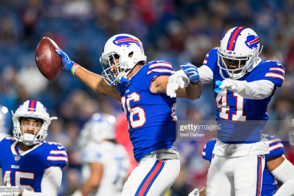 Greg Mabin #26 of the Buffalo Bills celebrates an interception with teammate Bradley Sylve #41 during the preseason game against the Detroit Lions on August 31, 2017 at New Era Field in Orchard Park, New York. Buffalo wins the preseason matchup over Detroit 27-17.