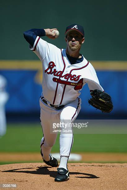 Greg Maddux of the Atlanta Braves throws a pitch during the game against the Montreal Expos on Opening Day at Turner Field on March 31 2003 in...