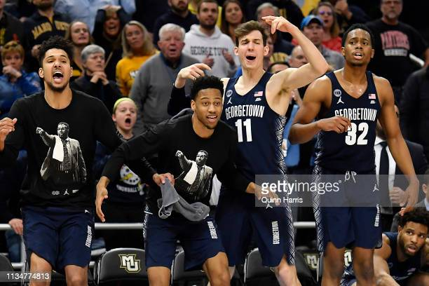 Greg Malinowski of the Georgetown Hoyas and teammates react from the bench during the second half of the game against the Marquette Golden Eagles at...