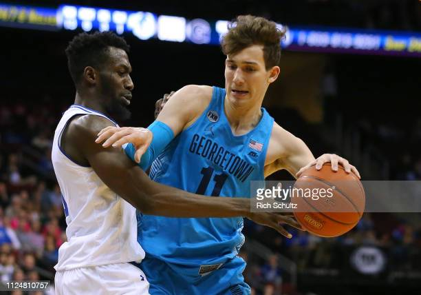 Greg Malinowski of the Georgetown Hoyas attempts to get past Michael Nzei of the Seton Hall Pirates during the first half of a game at Prudential...