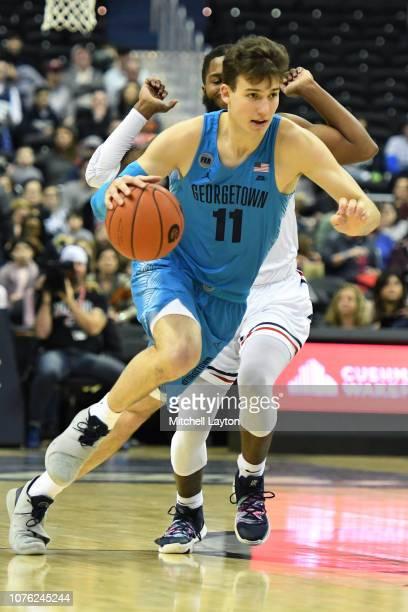 Greg Malinowski of the Georgetown Hoyas dribbles the ball during a college basketball game against the Howard Bison at the Capital One Arena on...