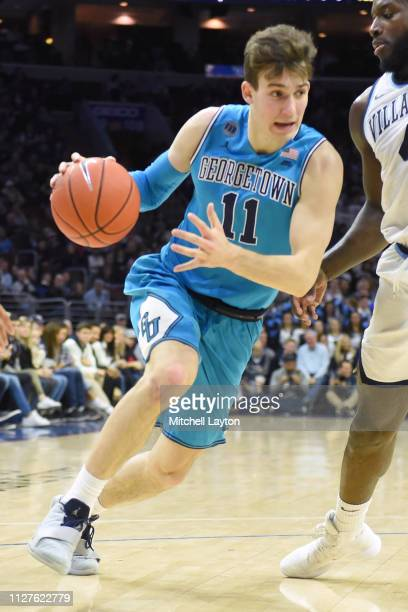 Greg Malinowski of the Georgetown Hoyas dribbles the ball during a college basketball game against the Villanova Wildcats at the Wells Fargo Center...
