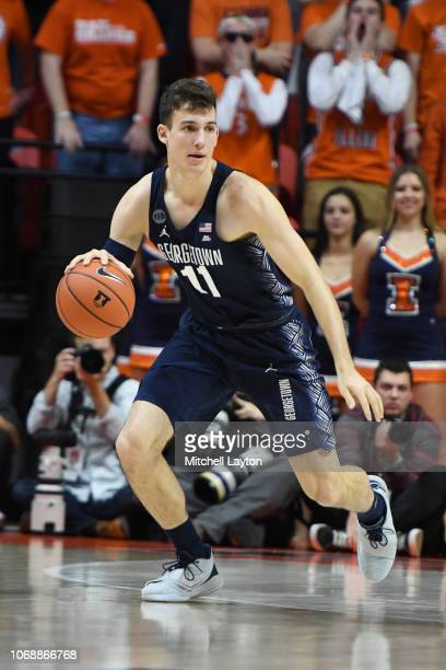 Greg Malinowski of the Georgetown Hoyas dribbles up court during a college basketball game against the Illinois Fighting Illini at the State Farm...