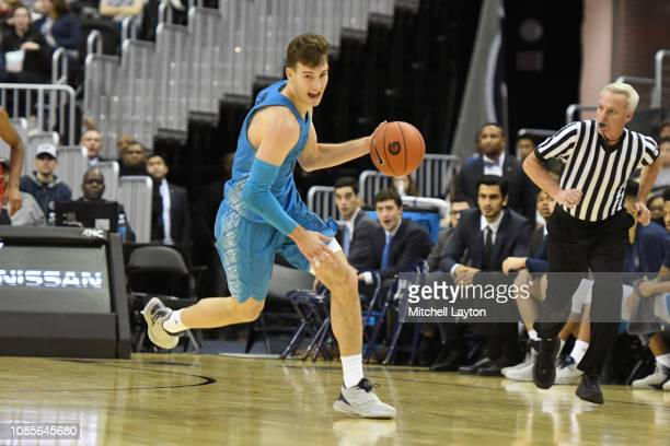 Greg Malinowski of the Georgetown Hoyas dribbles up court during a college basketball game against the Southern Methodist Mustangs at the Capital One...
