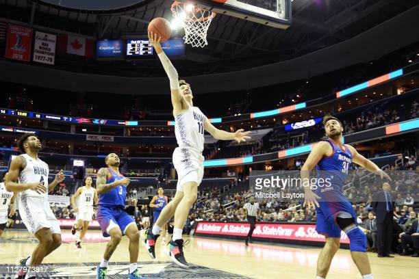 Greg Malinowski of the Georgetown Hoyas drives to the basket during a college basketball game against the DePaul Blue Demons at the Capital One Arena...