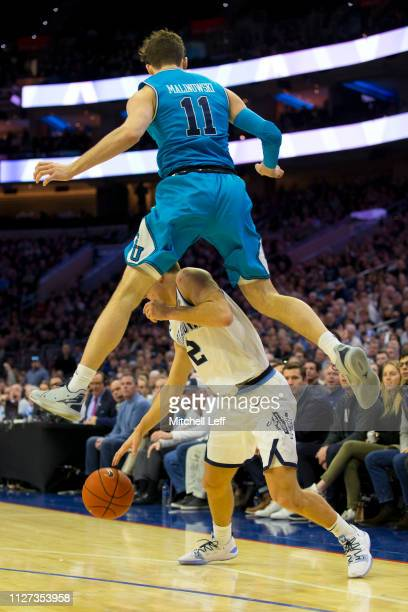 Greg Malinowski of the Georgetown Hoyas fouls Collin Gillespie of the Villanova Wildcats at the Wells Fargo Center on February 3 2019 in Philadelphia...