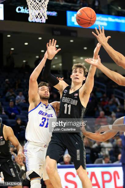 Greg Malinowski of the Georgetown Hoyas grabs a rebound in the game against the DePaul Blue Demons during the second half at Wintrust Arena on March...