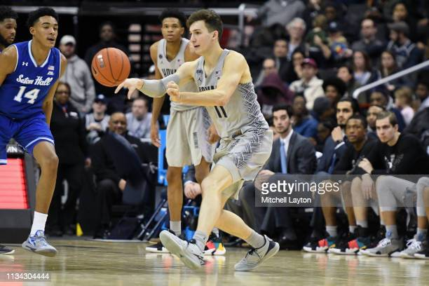 Greg Malinowski of the Georgetown Hoyas passes the ball during a college basketball game against the Seton Hall Pirates at the Capital One Arena on...