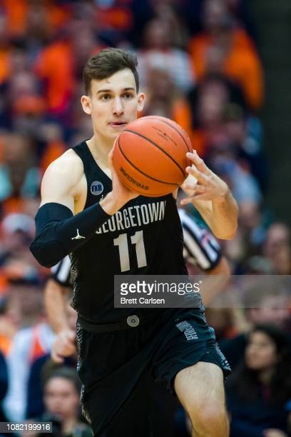 Greg Malinowski of the Georgetown Hoyas passes the ball during the first half against the Syracuse Orange at the Carrier Dome on December 8 2018 in...