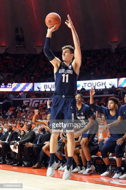 Greg Malinowski of the Georgetown Hoyas takes a jump shot during a college basketball game against the Illinois Fighting Illini at the State Farm...