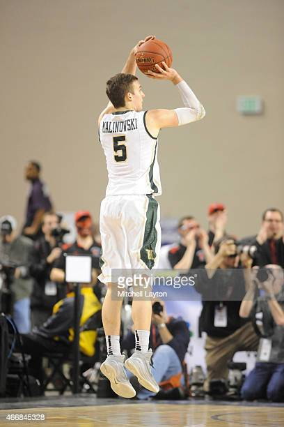 Greg Malinowski of the William Mary Tribe takes a jump shot during the Championship of the CAA Basketball Tournament against the Northeastern Huskies...