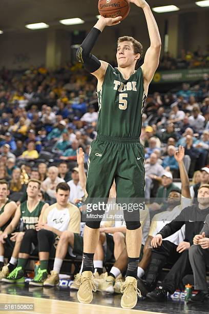 Greg Malinowski of the William Mary Tribe takes a jump shot during the semifinals of the Colonial Athletic Conference Tournament college basketball...