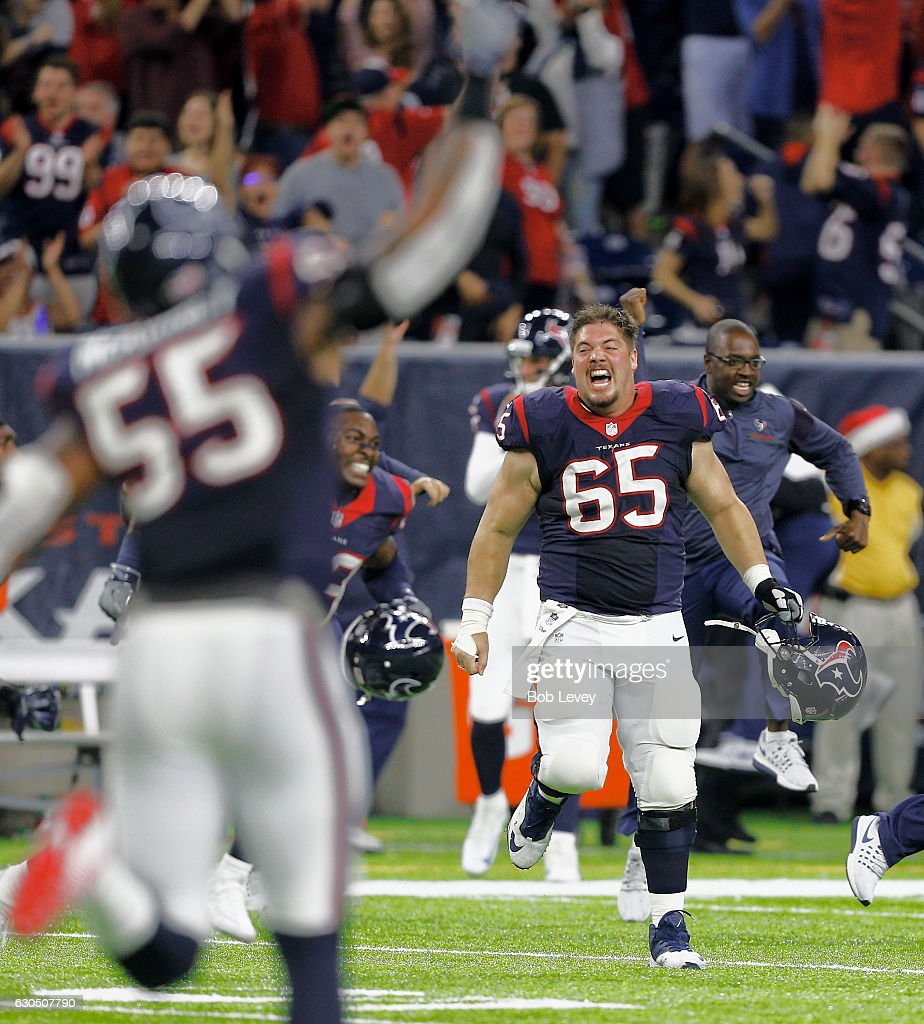 Greg Mancz #65 of the Houston Texans celebrates after Randy Bullock #4 of the Cincinnati Bengals misses a 43 yard field goal to give the Texans a 12=10 win at NRG Stadium on December 24, 2016 in Houston, Texas.